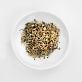 Herbal tea mixture in white dish