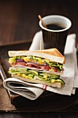 Club sandwich and cup of coffee