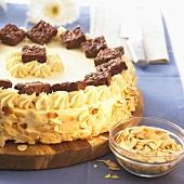 Malakoff cake with flaked almonds