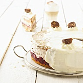 Nut cake with cherries and cream