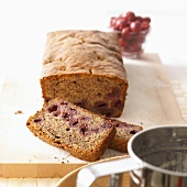Chocolate sour cherry loaf, partly sliced