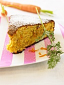 Piece of carrot cake with icing sugar