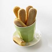 Sponge fingers in a green beaker
