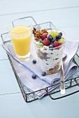 Fruit muesli and a glass of orange juice