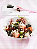 Salad leaves with goat's cheese, berries & balsamic vinegar