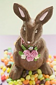 Chocolate Easter Bunny surrounded by sugar eggs