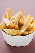 Potato wedges in white bowl