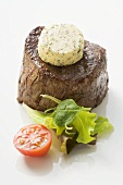 Beef fillet steak with herb butter, tomato, salad leaves