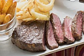 Beef steak with deep-fried onion rings