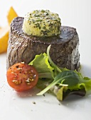 Beef fillet with herb butter, tomato and salad garnish