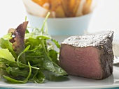 Beef fillet, a piece cut off, with salad