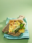 Spring vegetable quiche on chopping board