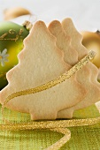Fir tree biscuits with gold ribbon