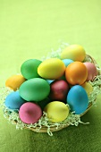 Coloured Easter eggs in a basket