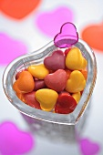 Coloured hearts in a glass dish