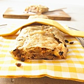 Apple strudel on checked cloth