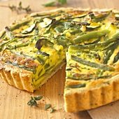 Green vegetable quiche with feta cheese, a piece cut