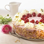 Raspberry cream cake with flaked almonds