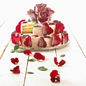 Wedding cake with red rose petals