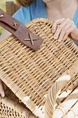 Woman opening a picnic basket