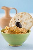 Sheep's cheese and pepper spread with olive and crackers