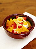 Fruit salad with tomatoes and cream