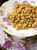 Yellow raspberries on a plate