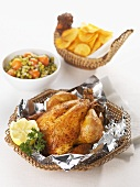 Roast chicken in a basket, mixed vegetables, potato crisps