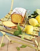 Lemon cake and fresh lemons on garden chair