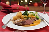 Duck breast, orange segments, broccoli, potato croquettes (Xmas)
