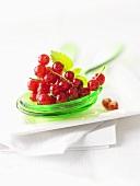 Redcurrants on salad servers