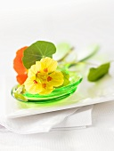 Nasturtium flowers on salad servers