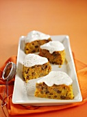 Several pieces of carrot cake