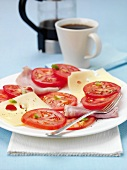 Breakfast: ham and cheese platter with tomatoes, coffee