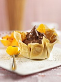 Mandarin oranges and chocolate cream in filo pastry shell
