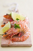 Prawns with lime wedges and parsley