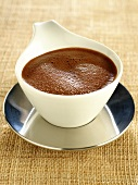 Hot chocolate sauce in sauce-boat