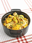Chicken with mango in a cast-iron pot