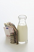 Bottle of milk and money