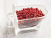 Red peppercorns in a glass container