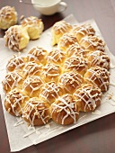 Yeast buns with lemon icing and almonds
