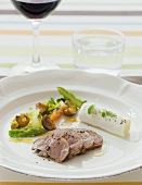 Lamb fillet with young vegetables and soft cheese roll