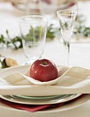 Festive place-setting with red apple (Sweden)
