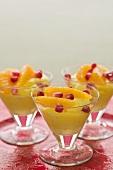 Saffron cream with pomegranate seeds and orange segments