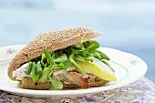 Chicken and corn salad in sesame bun