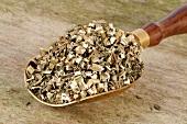 Dried Chinese motherwort (Yi Mu Cao) in scoop