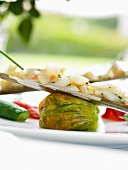 Stuffed courgette flower with accompaniments