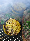Grilled lemons and chops on a barbecue rack