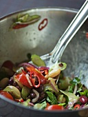 Vegetable salad with beans, chilli rings, tomatoes & onions