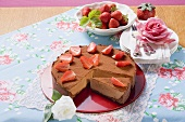 Chocolate cheesecake with strawberries and cocoa powder